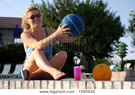 Girl By Pool Holding Basketball