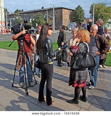 YAROSLAVL, RUSSIA - 11 SEPTEMBER: celebration of the millennium YAroslavl, Russia, September 11, 2010. The Interview on town street.