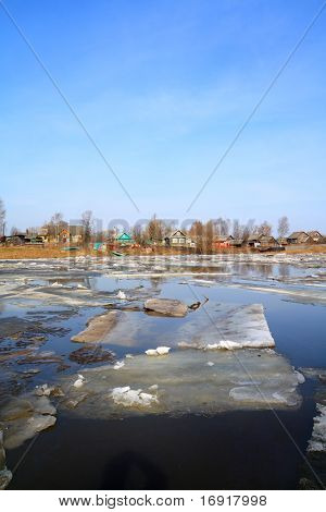 ice on river near villages