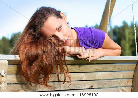 beautiful long-haired girl relaxing in park