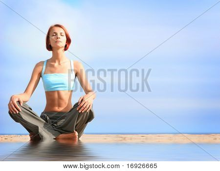young girl meditating on beach
