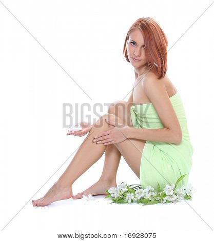 beautiful young woman caring for her legs