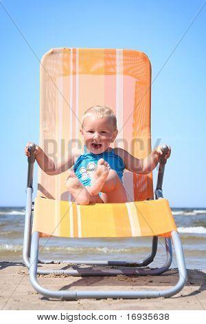 cute little girl relaxing on beach