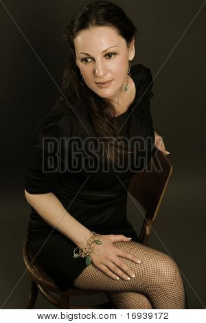 beautiful adult woman on dark background