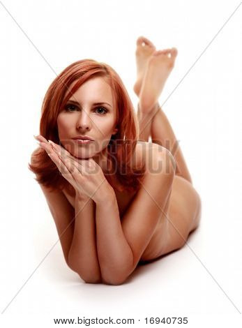 beautiful redhaired girl naked in studio