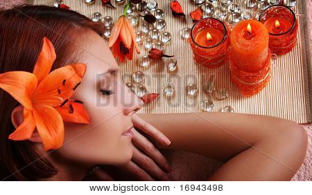 beautiful girl relaxing in spa salon
