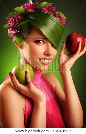 beautiful spring-woman with two apples