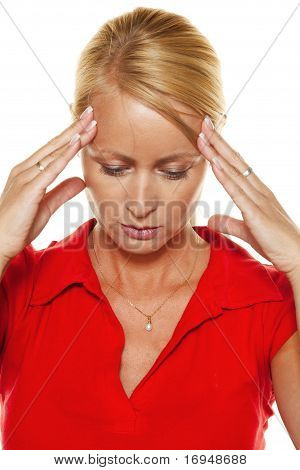 Pensive woman with headache