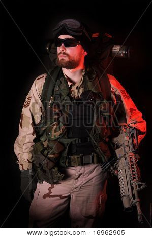 Warning Red. Special Forces Soldier At Night.