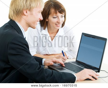 A man and a woman looking at the monitor