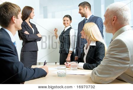Six business people working together in the office