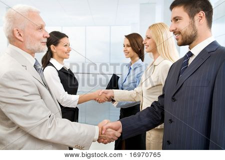 Business people shaking hands in a modern office