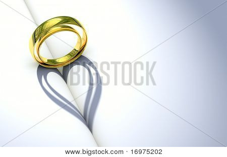 Wedding Ring and heart shaped shadow over a blank book