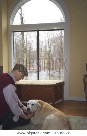 Man And His Dog In The Living Room Flood In Backyard