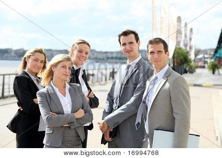 Group of business people standing outside a trade fair