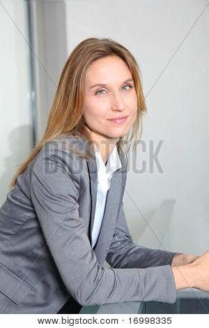 Portrait of blond businesswoman in grey jacket