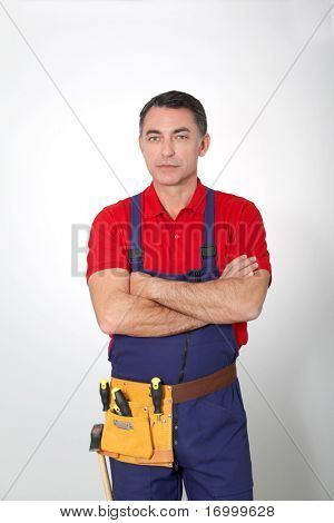 Carpenter with arms crossed on white background