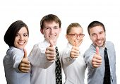 stock photo of thumbs-up  - Successful business team with thumbs up  - JPG
