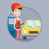 Worker of gas station filling up fuel into the car. Worker in workwear at the gas station. Gas stati poster