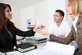 foto of real-estate agent  - Property owners getting keys of their home - JPG
