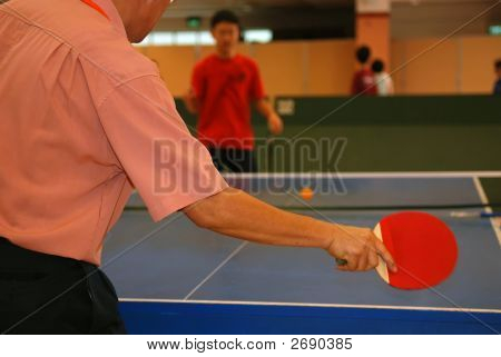 People Playing Table Tennis In The Sport Hall