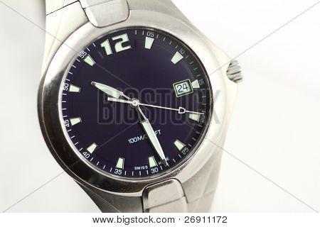 wristwatch on grey