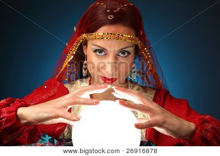 fortune teller with a shining crystal ball