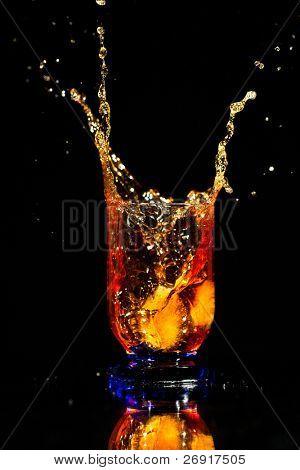 whiskey splash on black
