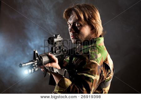 strikeball shooter holding a weapon