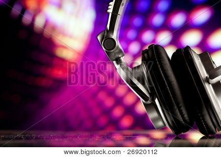 headphones against purple disco background