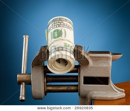 low budget concept - money in the vice tool