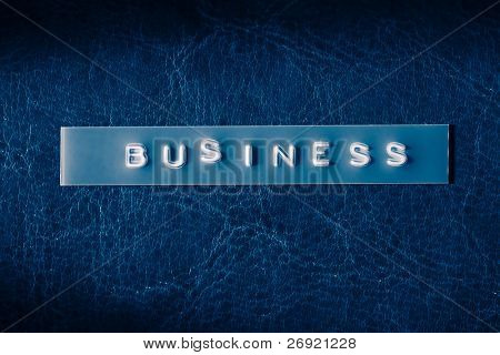business title on leather background