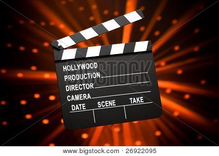 clapperboard against shiny background