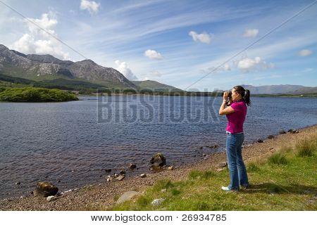 Photographer women in Connemara mountains terrain
