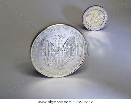 Dollar and euro coin with reflection