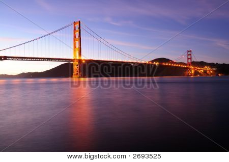 Glowing Golden Gate Bridge At Sunset