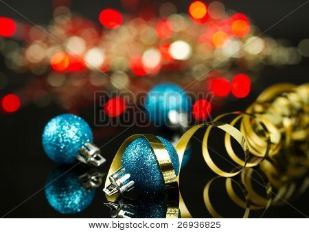 Christmas balls with blurry lights background