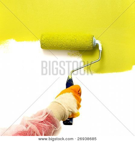 Roller painting wall on green color