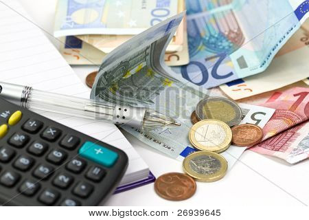 Euro money counting with calculator and pen