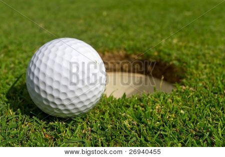 Golf ball just near the hole