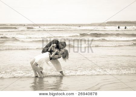Couple in romantic kiss on the beach