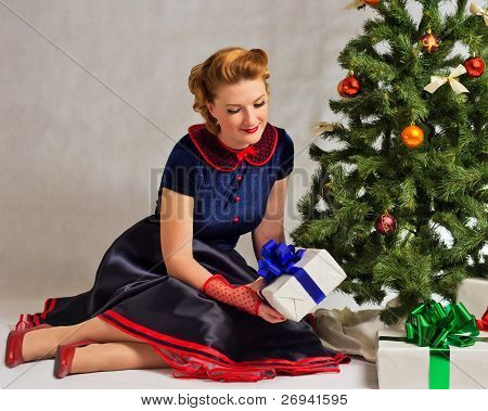 The lady next to Christmas tree