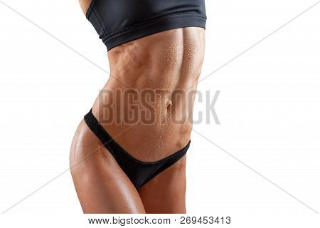 poster of Beautiful Super Fit Young Woman Showing Off Her Perfect Muscular Ripped Abs. Fitness Model. Perfect