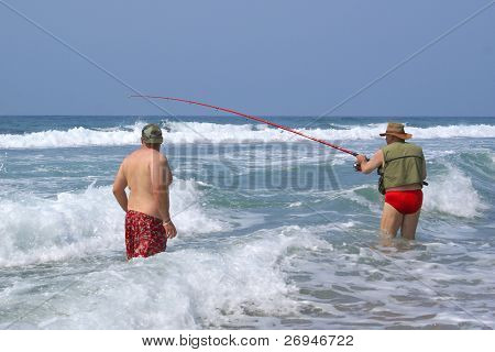 Father and son fishing in the sea