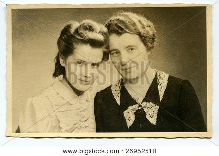 Vintage portrait of mother and daughter (twenties)