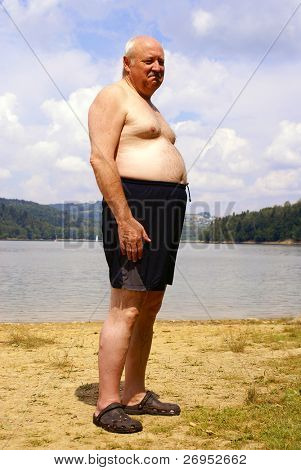 Overweight man with naked torso