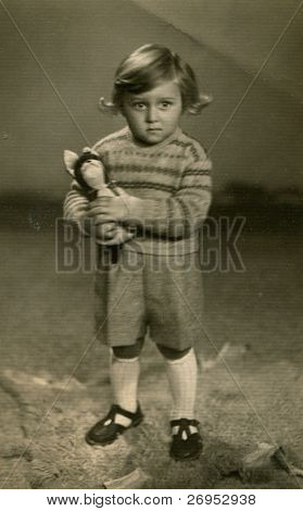 Vintage photo of boy with a toy (early fifties)