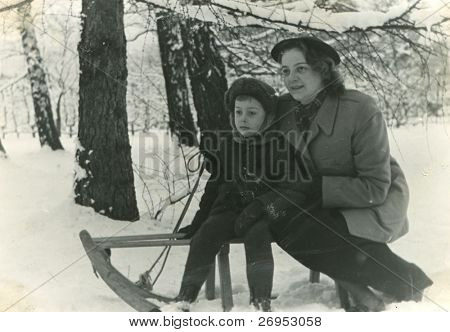 Vintage photo of mother and son on sled (early fifties)
