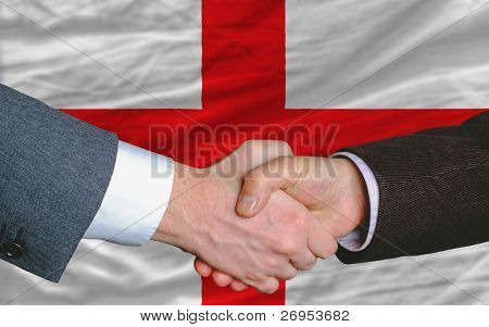 Businessmen Handshake After Good Deal In Front Of England Flag
