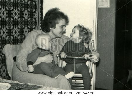 Vintage unretouched photo of mother with young children